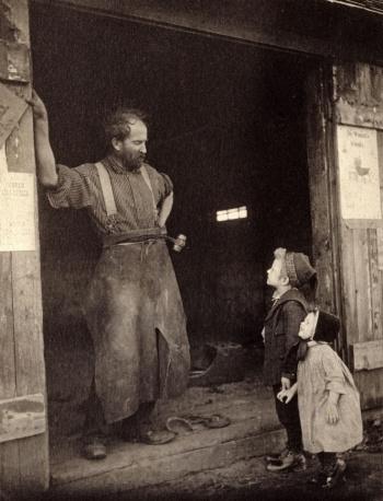 Blacksmith and children