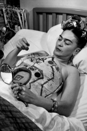 Frida Kahlo lies in hospital bed painting a collage on her plaster corset Photo: Juan Guzmán, 1951