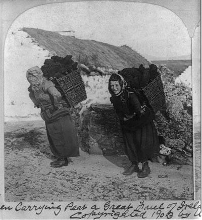 Women carrying peat, a great fuel of Ireland village Dooagh 1903