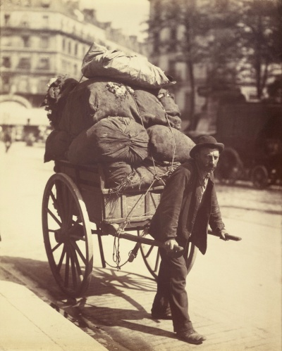 Rag pickers would sift through garbage heaps for discarded articles made of fabric. They would sell their findings by the pound to middlemen who would then sell the rags to companies that then used the materials to create new products like paper.Rag picker in Paris France, 1899-1901. (Photo credit: Eugène Atget (French, 1857 - 1927))