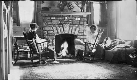 Figures around fireplace at Boyd Cottage