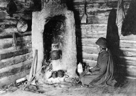 Native woman and fireplace