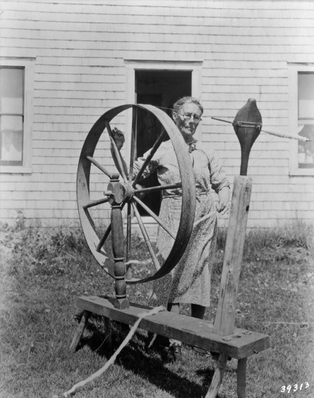 1936 82 year-old lady with her 125 year-old spinning wheel,