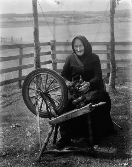 Cape Breton, N.S. - Old woman with spinning wheel. year unknown